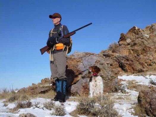 Man and dog looking for chukar